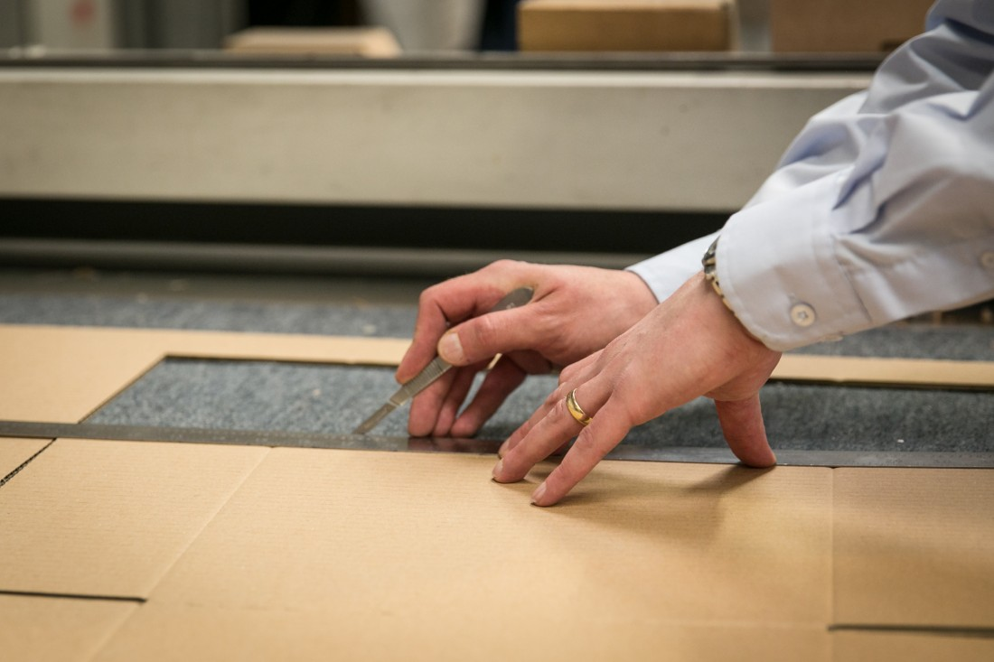 cutting cardboard with ruler